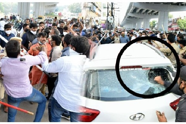BJP workers attacks minister Puvvada Ajays convoy