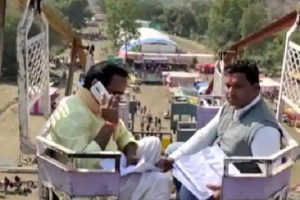 MP minister climbs atop village fair swing for phone signal