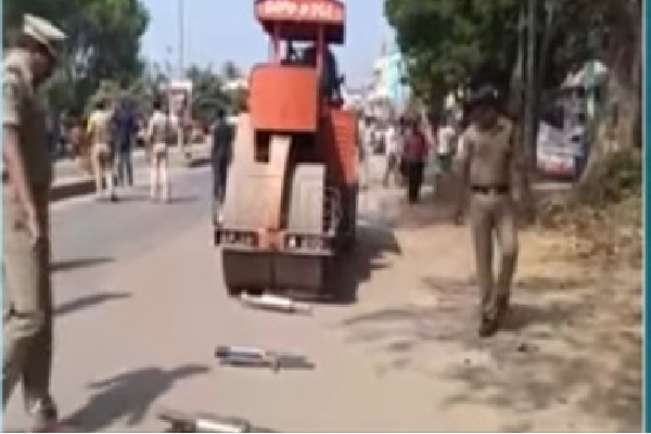Police crushed heavy noisy silencers with a road roller