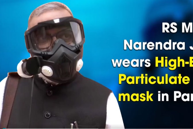 Rajya Sabha MP Narendra Jadhav wears High Efficiency Particulate Air filter mask in Parliament