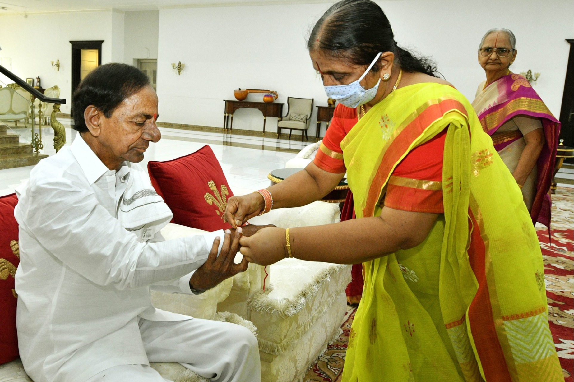 CM KCR sisters ties Rakhis to their beloved younger brother