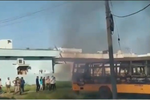 School buses parked near a church in Pulivendula caught in fire