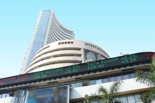 Sensex ends 748 points high