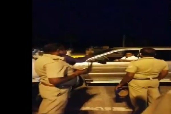 Former MP K Arjunan hits a police personnel on duty near Salem check post