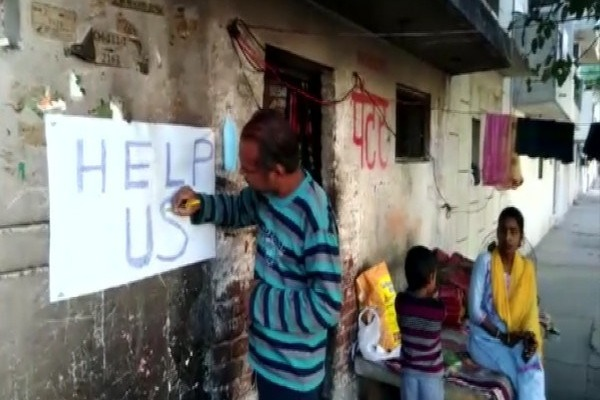 No work due to lockdown painter writes Help Us on wall of house