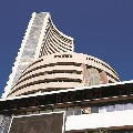 Sensex closes 694 points low