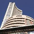 Sensex closes 746 points low
