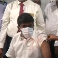 minister takes corona vaccine