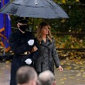 Melania Trump walks with soldier