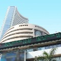 Sensex ends 593 points higher