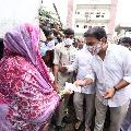 KTR distributes financial help to flood effected poeple