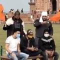 Youth held waving saffron flags at Taj Mahal