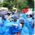 NSUI cadre wearing PPE Kits protests at Pragathi Bhavan