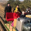 Russian embassy employs travel on railway trolley to reach Russian land