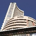 Sensex closes 749 points high