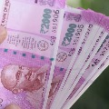 2000 note printing not stopped says Centre