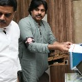 Pawan Kalyan wears Specially designed badge in Prakasham district