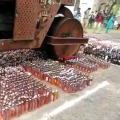 liquor worth seventy two lakhs destroyed with a road roller