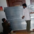 BBMP Officials Seal Two Houses with Metal Sheets