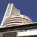Sensex ends 506 points high