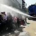 Migrant workers sprayed with disinfectant in  Delhi