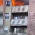 Man catches three year old dropped from burning building