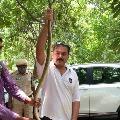 Hyderabad CP Anjani Kumar captures a snake