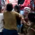 Angry woman grabbed and beaten a girl