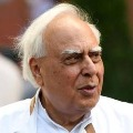 There is no intention to criticise Gandhis family says Kapil Sibal