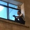Palestinian climbs wall to see mom through window before she dies of COVID