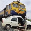 Rail engines drags car for 200 m in Kadapa Dist
