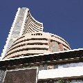 sensex ends 113 points high