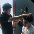 Sachin turns hairstylist for his son