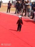Little Kejriwal enjoying while Senior one taking Oath as CM of Delhi