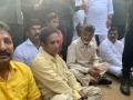 Chandrababu sits down on road at Vizag airport