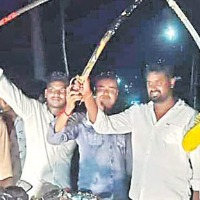 Youngsters with swords during birthday celebrations in Mummidivaram