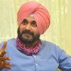 Navjot Singh Sidhu mimics a batting style