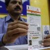 AP postal Department linking mobile number with Aadhar at door step
