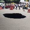 Heavy Pit Hole Middle Of The Road Under Fly Over