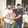 Chiranjeevi gifts a pen to his director Bobby