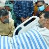 Chandrababu meets TDP follower in hospital