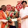 Pawan Kalyan handed cash cheque to Kinnera artist Mogulaiah