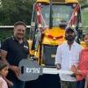 Prakash Raj gifts JCB to a poor family