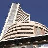 Sensex closes 958 points high