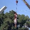 Taliban hangs dead body to a crane