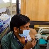 Ahmedabad Officials announce mobile phone and oil packets for vaccination