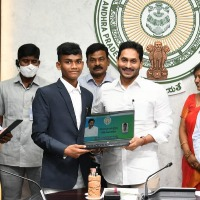 CM Jagan presents laptops to SC and ST IIT rankers