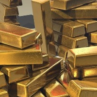 devotee gives gold biscuits for ttd
