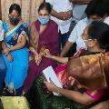 Home minister Mekathoti Sucharitha visits Varalakshmi house in Gajuwaka