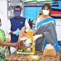 Anasuya helps Pochampally Hand loom workers